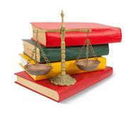 Scales of justice atop legal books over white Stock Images