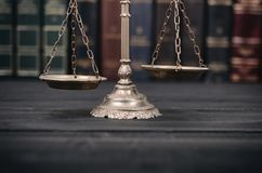 Scales of Justice on a black wooden background. Law and Justice, Legality concept, Scales of Justice on a black wooden background Royalty Free Stock Photography