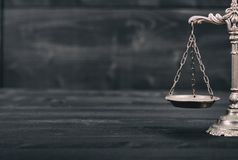 Scales of Justice on a black wooden background. Law and Justice, Legality concept, Scales of Justice on a black wooden background Stock Image