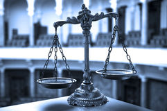 Scales of Justice in the Courtroom Royalty Free Stock Photo