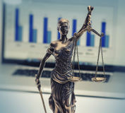 Scales of justice - financial records. Laptop computer Royalty Free Stock Photography