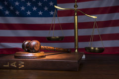 Scales of Justice. Justice gavel with American flag in the background Stock Photos