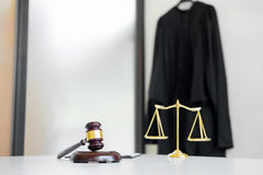 Scales of justice and gavel Judge hammer on brown wooden desk wi Royalty Free Stock Images