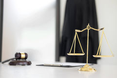 Scales of justice and gavel Judge hammer on brown wooden desk wi Stock Photo