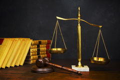 Scales of Justice. With gavel and law books in the background Royalty Free Stock Image