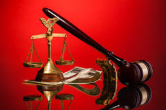 Scales of justice gavel and money Stock Photography