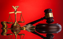Scales of justice gavel and money Stock Images