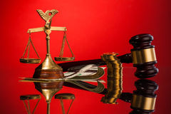 Scales of justice gavel and money Stock Photos