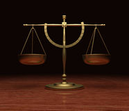 Scales Of Justice. Gold Scales of Justice on polished wood Stock Photo