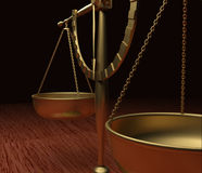 Scales Of Justice. Gold Scales of Justice on polished wood Stock Image