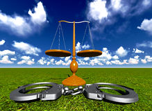 Scales of justice and handcuffs Stock Photo