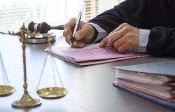 Scales of justice with judge gavel on table. Scales of justice with judge gavel on  table Stock Photography