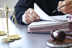 Scales of justice with judge gavel on table Stock Image