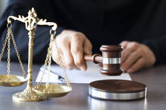 Scales of justice with judge gavel on table Royalty Free Stock Photo