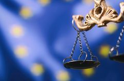 Scales of Justice, Justitia, Lady Justice in front of the European Union flag. Law and Justice, Legality concept, Scales of Justice, Justitia, Lady Justice in Stock Photo