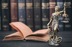 Scales of Justice, Justitia, Lady Justice and Law books. Stock Photo