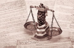 Scales of justice , law concept. Scales of justice , American flag and US Constitution Stock Image