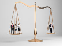 Scales of justice with people. Scales of justice with businesspeople on light grey background stock photography