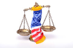 Scales of justice rolled up with  American flag . Royalty Free Stock Photos