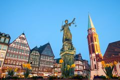 Scales of Justice at Romerberg square in Frankfurt. Scales of Justice at Romerberg square, the old town center, and the Romer, with the Old Nikolai Church Stock Photography