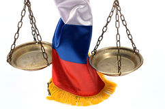 Scales of Justice and Russian Federation flag Royalty Free Stock Image
