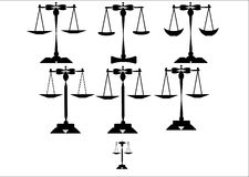 Scales of justice set. Series of scales of justice on white silhouettes Royalty Free Stock Photos