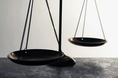 Scales of justice on table, closeup Stock Image
