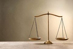 Scales of justice on tabl. E. Law concept royalty free stock photography
