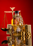 Scales of justice and whisky bottle Stock Photo