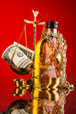 Scales of justice and whisky bottle Royalty Free Stock Photography