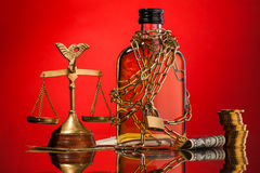 Scales of justice and whisky bottle Stock Photos