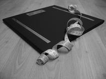 Scales with measuring tape royalty free stock photography