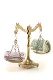 Scales with money Stock Photography