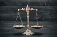 Scales Of Justice On A Black Wooden Background. Royalty Free Stock Photography