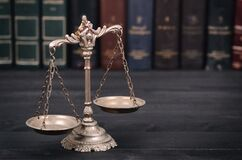 Scales Of Justice On A Black Wooden Background Royalty Free Stock Image
