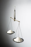 Scales out of balance. On the scales of two bowls unbalance royalty free stock image