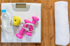 Scales, and sports equipment for active exercises. And weight loss plan view of the floor Royalty Free Stock Image