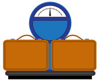 Scales with suitcases Royalty Free Stock Photos