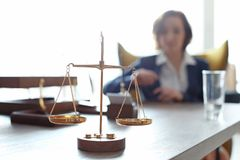 Scales on table and lawyer. In office stock photos