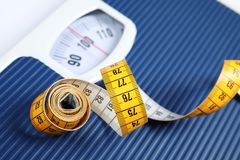 Scales with tape measure, closeup view royalty free stock photography