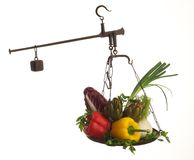 Scales with vegetables Royalty Free Stock Photo