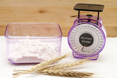 Scales with wheat flour Stock Photography