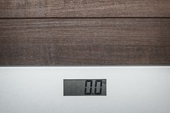 Scales on the wooden floor Royalty Free Stock Photo