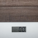 Scales on the wooden floor Stock Photography