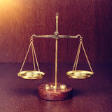 scales on wooden table Royalty Free Stock Photo