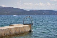 Scaletta per nuoto fotografia stock
