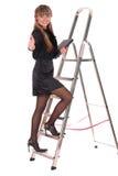 Scaletta rampicante della donna di affari Fotografie Stock