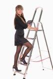 Scaletta rampicante della donna di affari Fotografie Stock Libere da Diritti
