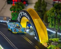 Slot cars. Scalextric slot car on race track Stock Photography