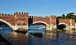 Scaliger Bridge over Adige River in Verona, Italy. The medieval Scaliger Bridge, a famous landmark in the city of Verona, with ghibellin battlements Royalty Free Stock Photos